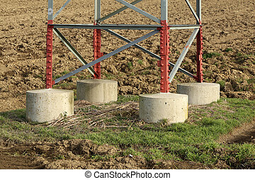 The foundation on which the high voltage mast stands