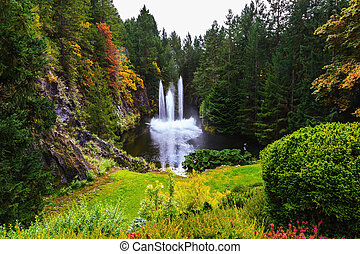 The fountain in a quiet pond - Butchart Gardens on Vancouver...