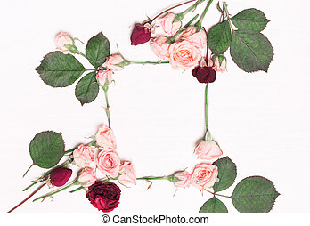 The frame arrangement of pink roses, red flowers.