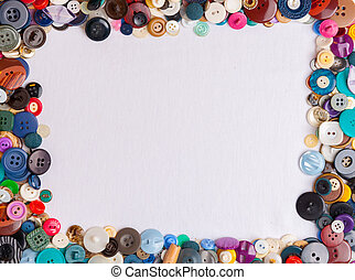 The frame is lined with old colored buttons for background