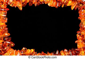 The frame is made of amber on a black background, art design creative design.