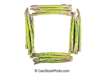 The frame made of fresh asparagus on a white background