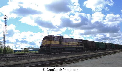 The freight train is passing by on a sunny day