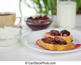 The French bread fried and slathered with plum jam. - ...