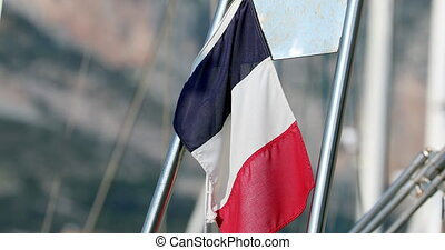French Flag or Tricolor Flying From The Stern of a Boat -...