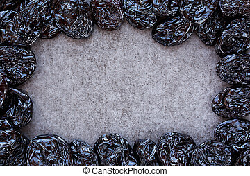 The french plum - Frame of French plums on grey background