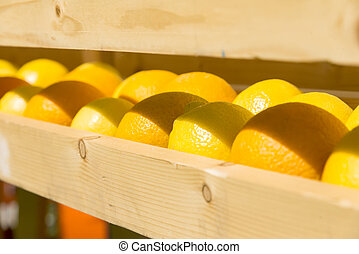fresh oranges in a wooden box