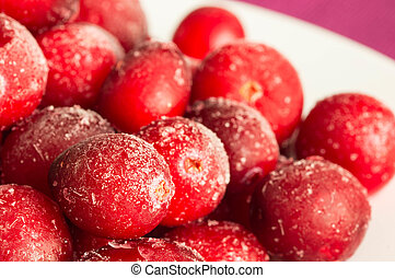 The frozen berries of a cranberry
