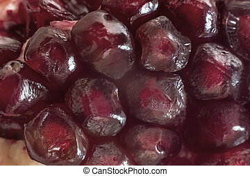 The fruits of pomegranate seeds with juicy pulp