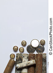 The fulfilled batteries of the different size covered with corrosion. Recycling.