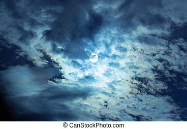 The full moon in the night sky