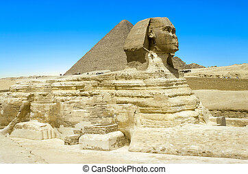 full profile of the Great Sphinx with the pyramid in the backgr