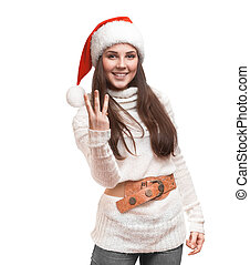 The fun girl is standing in the sweater