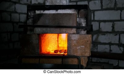 The furnace of a blacksmith in the forge, slider
