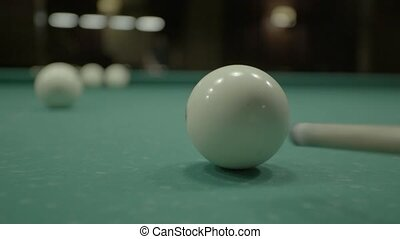 The game of billiards on the billiard table.