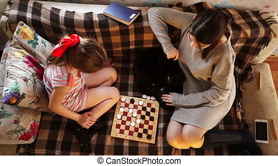 The game of checkers of two sisters top view