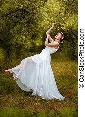 The garden is a beautiful girl soars. She in lightweight ...