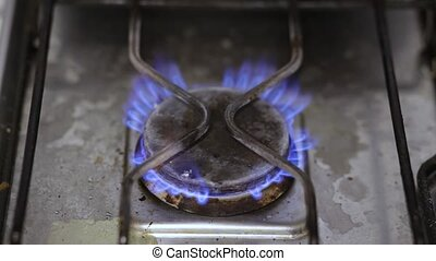 The gas burner burns with a blue flame. Cooker for cooking.