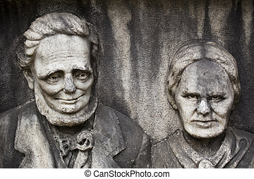 The Gentle Man and His Crazy Wife - 150-year-old statue in a...