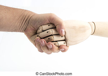 the gesture of a handshake made with a jointed wooden hand