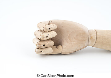 the gesture of a jointed wooden hand resting on the table