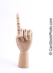 the gesture of the number one made with a jointed wooden hand