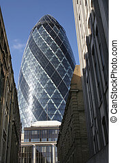 The Gherkin - The ultra-modern skyscraper towers framed by...