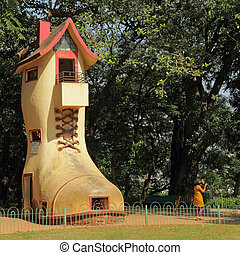 The giant Shoe House for children in Hanging Gardens and the...