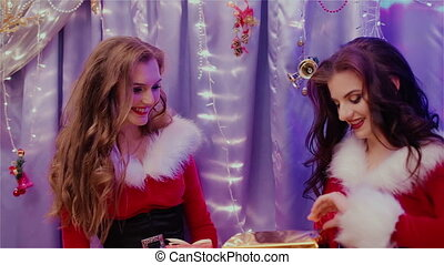 The gift for the new year two beautiful girls