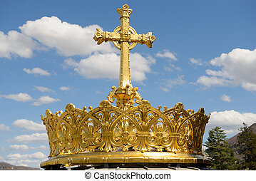 The gilded crown ad cross in Lourdes - The gilded crown ad...