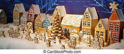 The gingerbread house is standing