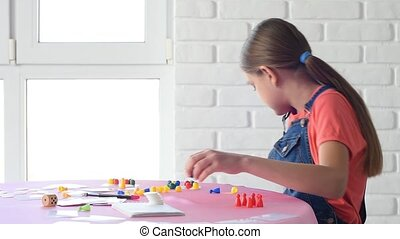 The girl alone plays board games at home and dropped the ...