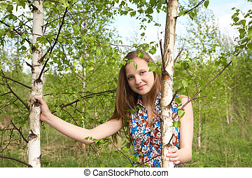 The girl among young birches
