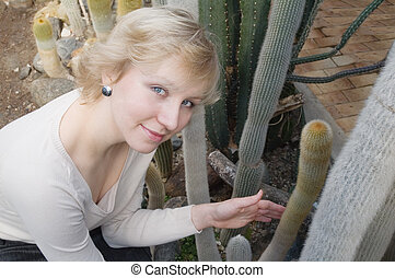 The girl and a cactus