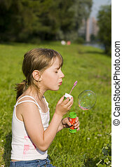 The girl and a soap bubble
