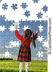 The girl assemble big puzzle. Landscape on a picture