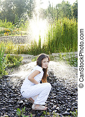 The girl at a fountain in park