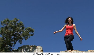 The girl at the edge of the cliff