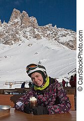 The girl at the table mountain cafe. Ski resort of Selva di Val Gardena, Italy