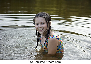 The girl bathes in lake