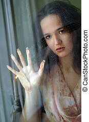 The girl behind glass