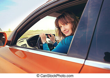 the girl behind the wheel of a car