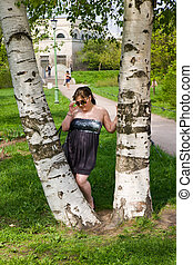 The girl between two birches