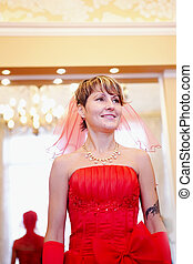 The girl bride in a red dress