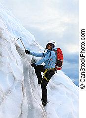 The girl climbing on the glacier. Falljokull Glacier (...