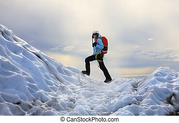 The girl climbing the glacier. Falljokull Glacier (Falling...