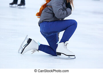 the girl climbs after falling on skates