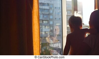 the girl closed the curtains on a Sunny day