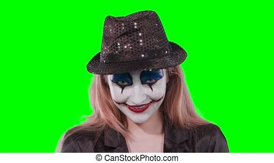 The girl clown looking at the camera.
