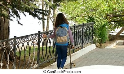 The girl comes back from school. - The girl is walking along...
